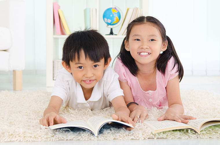Two children read together