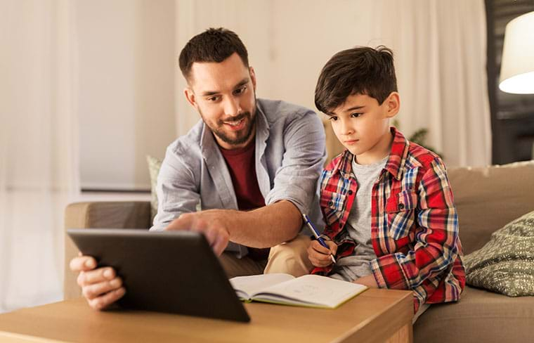 A parent helps his child with homework